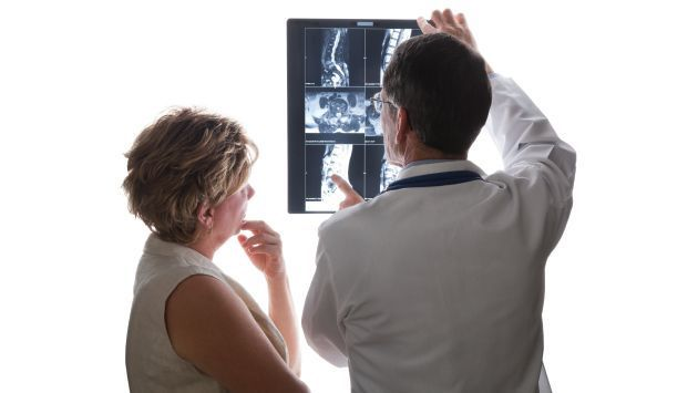 Doctor Viewing MRI Scans with Woman Patient