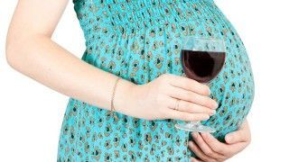 Red wine during pregnancy.Isolated over white